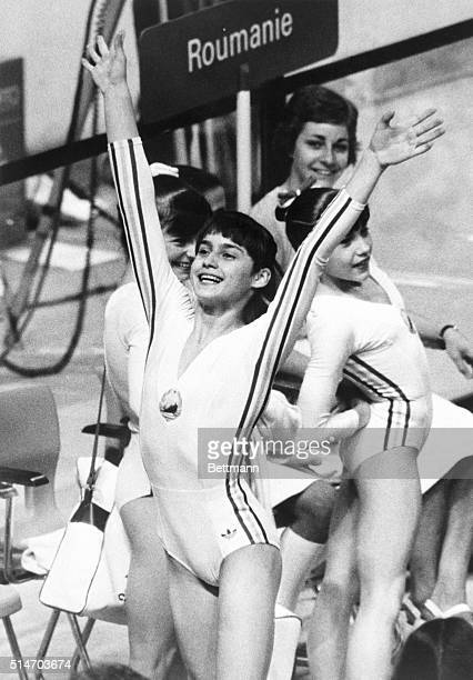 Romanian gymnast Nadia Comaneci celebrates after scoring a perfect 1000 in competition at the 1976 Summer Olympics in Montreal Canada