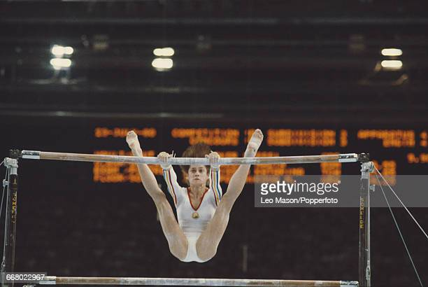 Romanian gymnast Nadia Comaneci pictured in action during competition on the uneven bars part of the women's artistic team allaround competition at...