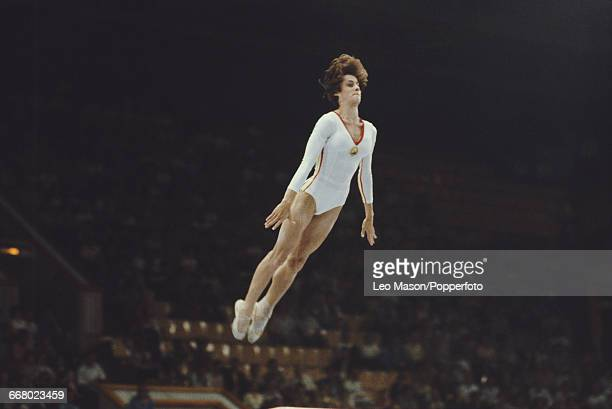 Romanian gymnast Nadia Comaneci pictured in action during competition in the floor exercise part of the women's artistic team allaround competition...