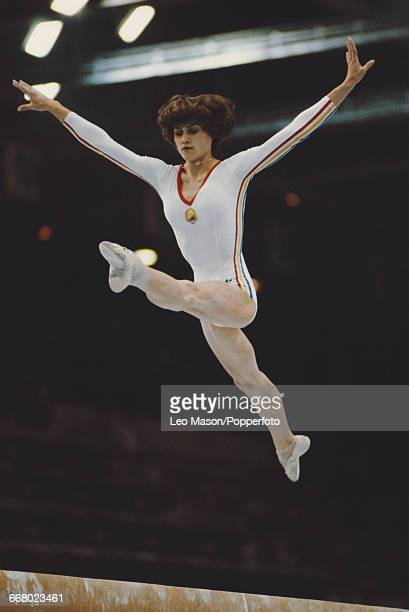 Romanian gymnast Nadia Comaneci pictured in action during competition on the balance beam part of the women's artistic team allaround competition at...