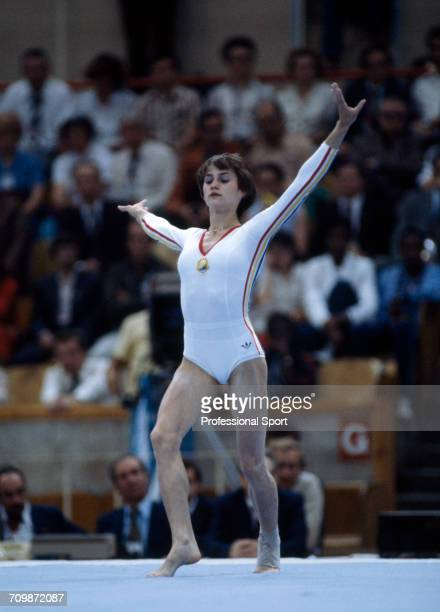 Romanian gymnast Nadia Comaneci pictured in action in the floor exercise during competition in the women's artistic team allaround competition at the...