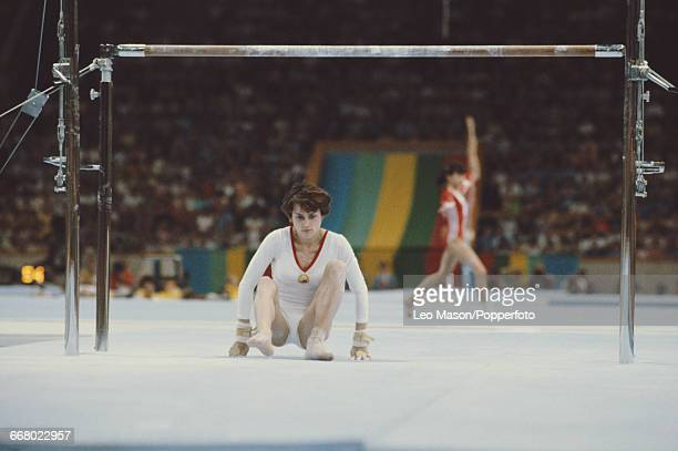 Romanian gymnast Nadia Comaneci pictured in action taking a fall during competition on the uneven bars during the women's artistic team allaround...