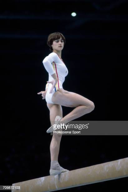 Romanian gymnast Nadia Comaneci pictured in action to win the gold medal on the balance beam during competition in the women's artistic team...