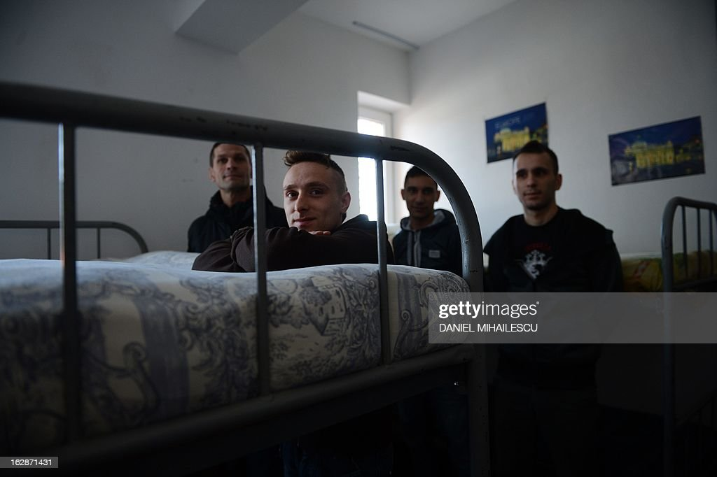 Romanian inmates from Jilava prison (next to Bucharest) are pictured in their dormitory on February 28, 2013. A day after a conference on drug abuse and rising HIV in prisons in Eastern Europe The Council of Europe organized a media visit to the prison as inmates in Jilava prison and two other Romanian jails have benefited from anti-drugs programs funded by the Norwegian government. Providing drug substitution treatment and distributing needles and condoms are key steps to curb addiction and HIV infection among inmates across Europe, experts warn, calling on authorities to change their approach to prison health-care. In Romania, the prison of Jilava, south of Bucharest, has recently introduced the system.