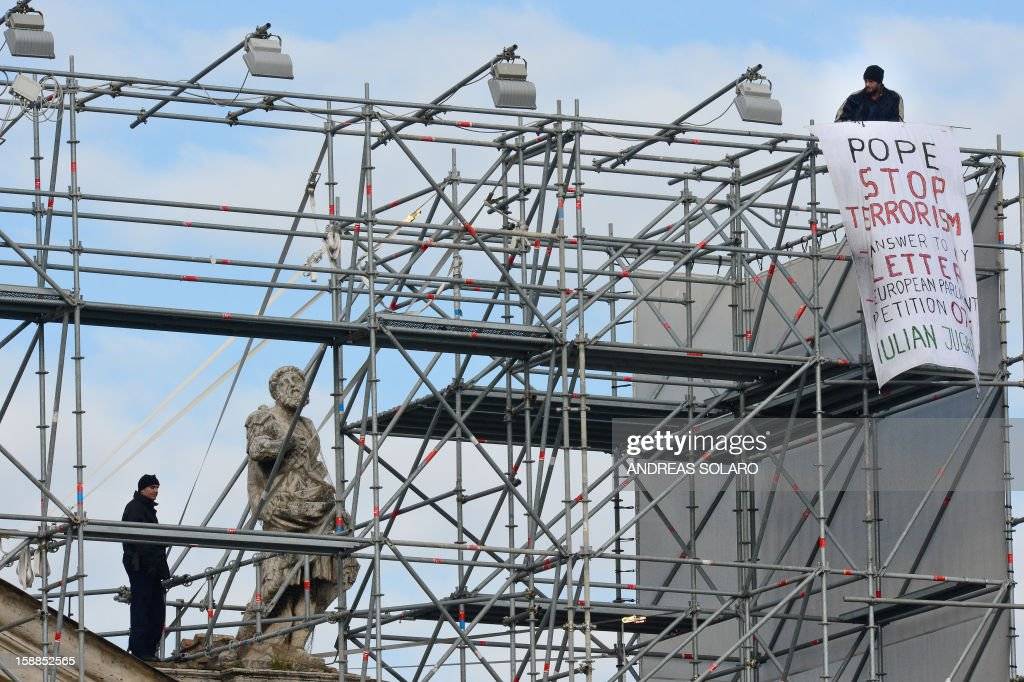 Romanian Iulian Jugarean climbed up the colonnade of St. Peter Square to protest against Pope Benedict XVI during his speech to faithfuls after the solemnity of Mary the Mother of God mass and the 46th World Day of Peace on January 1, 2013. AFP PHOTO / ANDREAS SOLARO