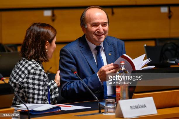Romanian Justice Minister Tudorel Toader talks with his advisor during a Justice amd Home Affairs Council meeting at the Congress Palace in...