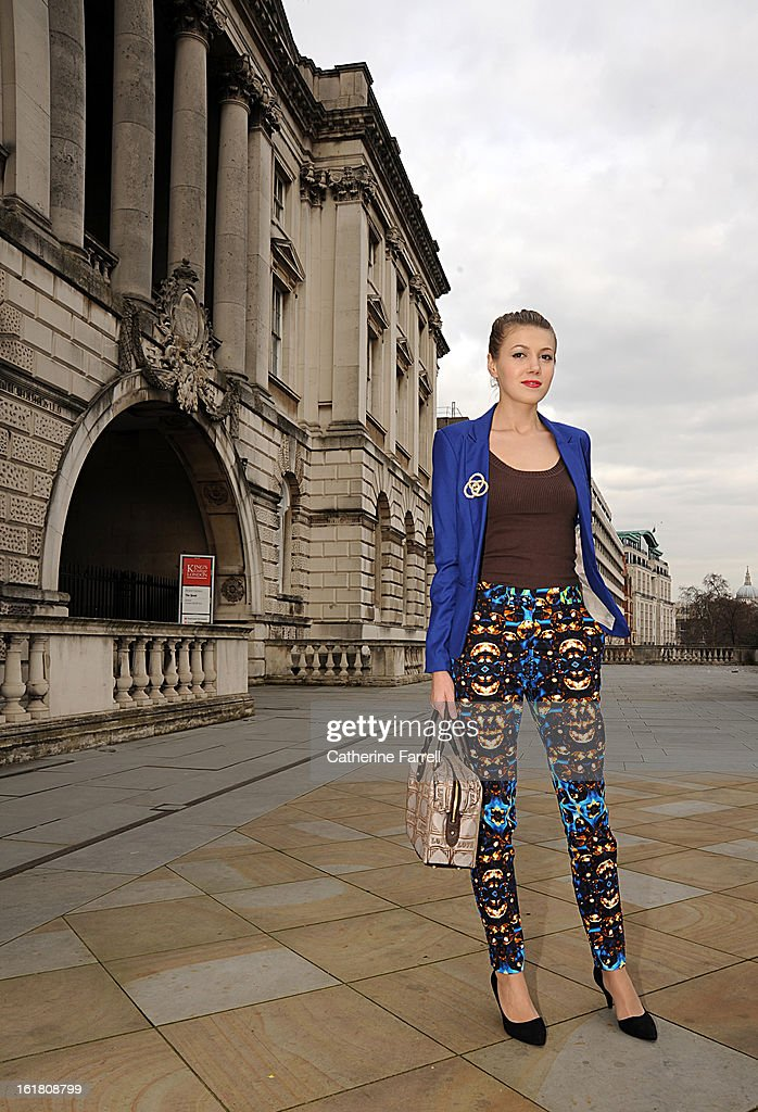 Romanian lifestyle blogger Juilana Butnariu wears and electric blue monchrome Benshka single breasted jacket, Mango top, ASOS slim printed cigarette trousers, ASOS shoes and River Island bangles during London Fashion Week Fall/Winter 2013/14 on February 16, 2013 in London, England.