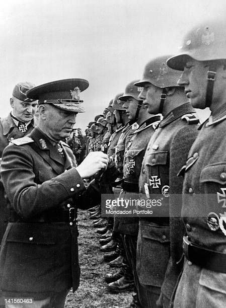 Romanian Marshal Ion Victor Antonescu conferring a decoration to a group of German soldiers after their victorious actions in Crimea May 1942