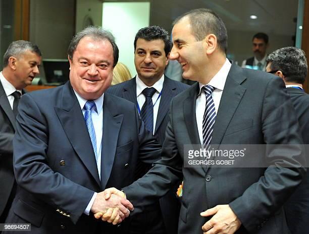 Romanian Minister of Administration and Interior Vasile Blaga shakes hand with Bulgarian Interior Minister Tsvetan Tsvetanov prior to the Justice and...