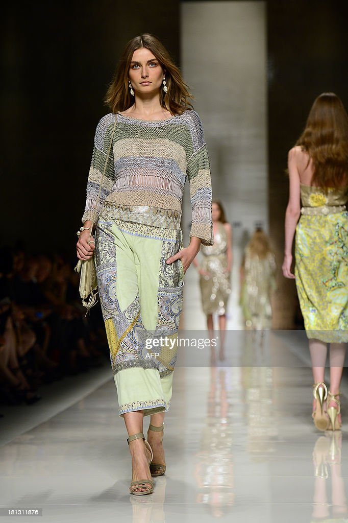 Romanian model Andreea Diaconu presents a creation for fashion house Etro as part of the spring/summer 2014 ready-to-wear collections during the fashion week in Milan on September 20, 2013.