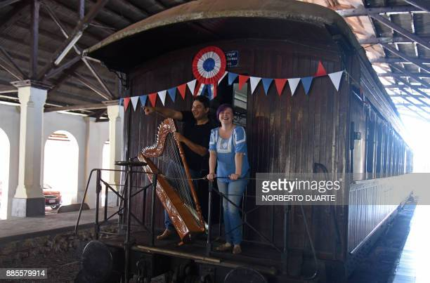 Romanian musician living in Paraguay Cristina Bitiuska is pictured next to her husband Paraguayan harpist Alcides Ovelar during an interview with AFP...