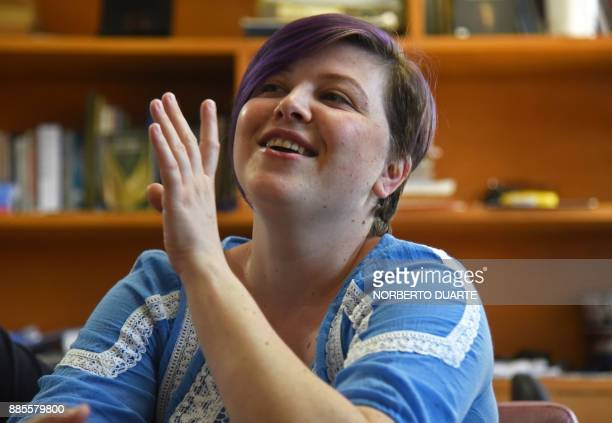 Romanian musician living in Paraguay Cristina Bitiuska speaks with AFP during an interview in Asuncion on November 30 2017 Bitiuska is a Romanian...