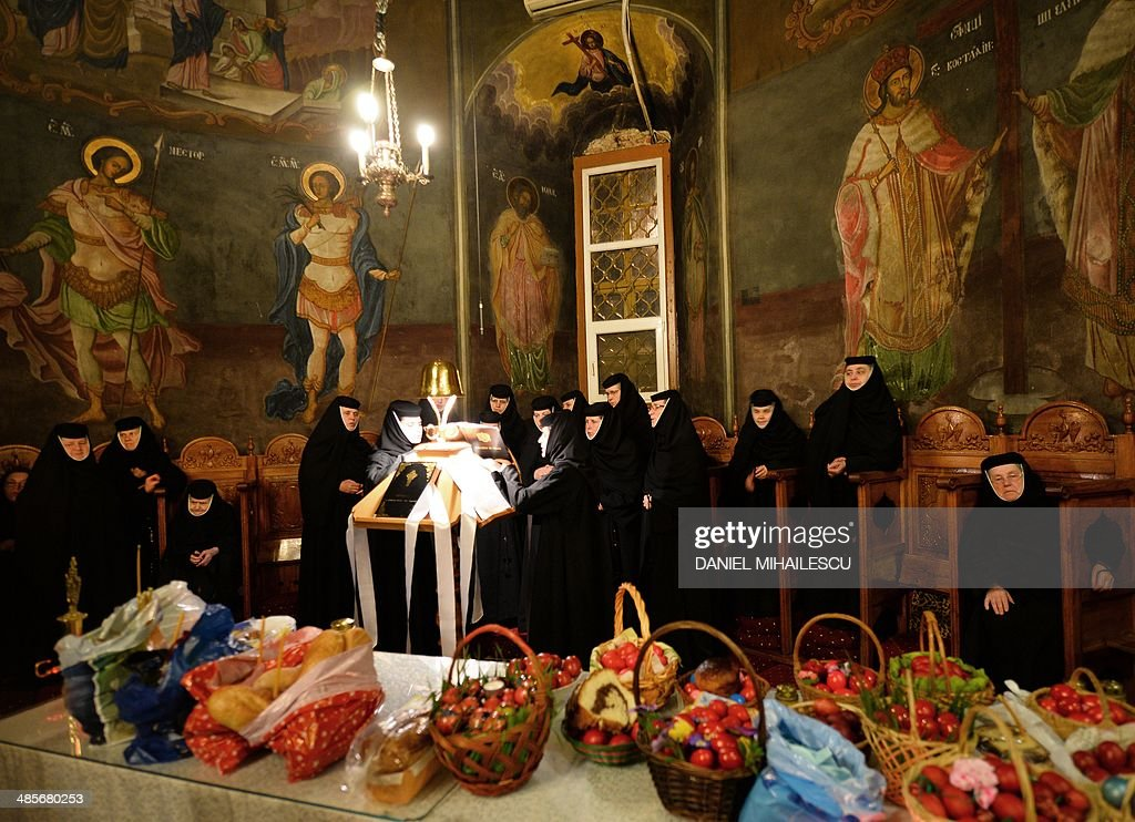 Romanian Orthodox nuns sing next to basket with painted eggs during Easter celebration at Pasarea Monastery near to Bucharest April 20, 2014.