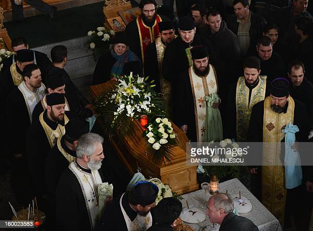 Romanian orthodox priests celebrate the funeral service for Tiberiu Ionut Costache one of the two Romanian victims who were killed during the...
