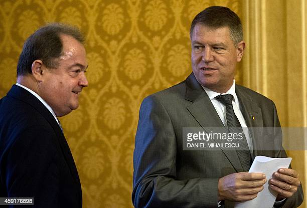 Romanian President elect Klaus Iohannis arrives for a press conference with Vasile Blaga of National Liberal Party at the Parliament Palace in...