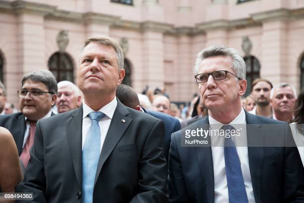 Romanian President Klaus Iohannis and German Interior Minister Thomas De Maiziere attend a Commemoration day for the Victims of escape and eviction...