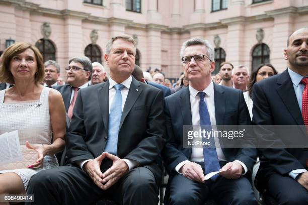 Romanian President Klaus Iohannis with his wife Carmen Iohannis and German Interior Minister Thomas De Maiziere attend a Commemoration day for the...