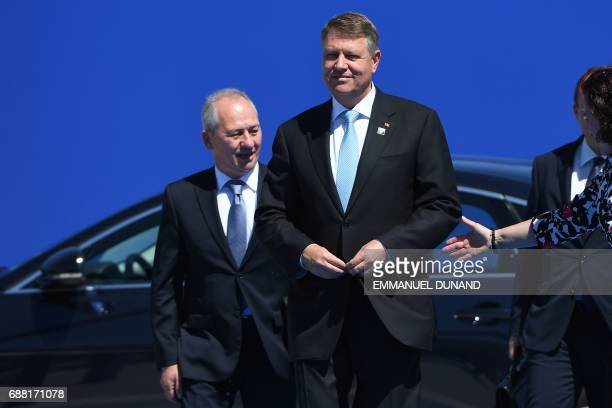Romanian President Klaus Werner Iohannis flanked by NATO's Romanian Ambassador Stelian Stoian arrives for the NATO summit at the NATO headquarters in...