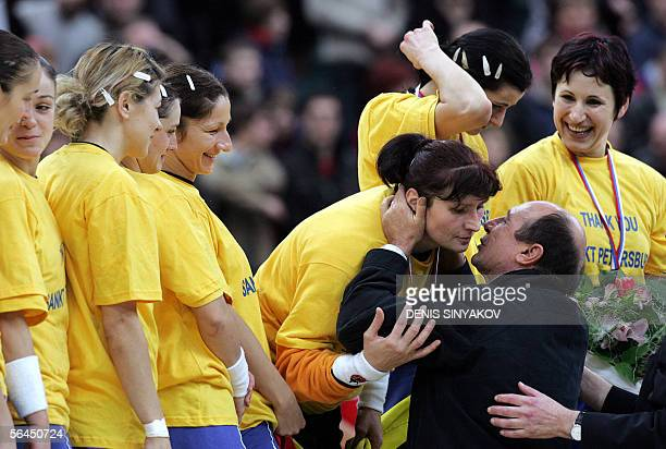 Romanian President Traian Basescu congratulates Romanian goalkeeper Paula Radulescu with her silver medal during an awarding ceremony after the...