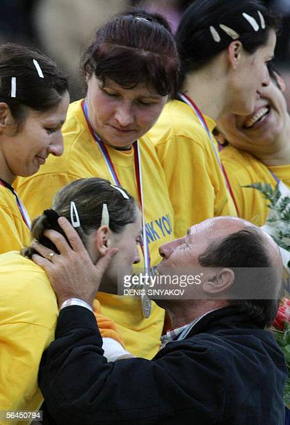 Romanian President Traian Basescu congratulates Romanian players with their silver medals during an awarding ceremony after the RussiaRomania...
