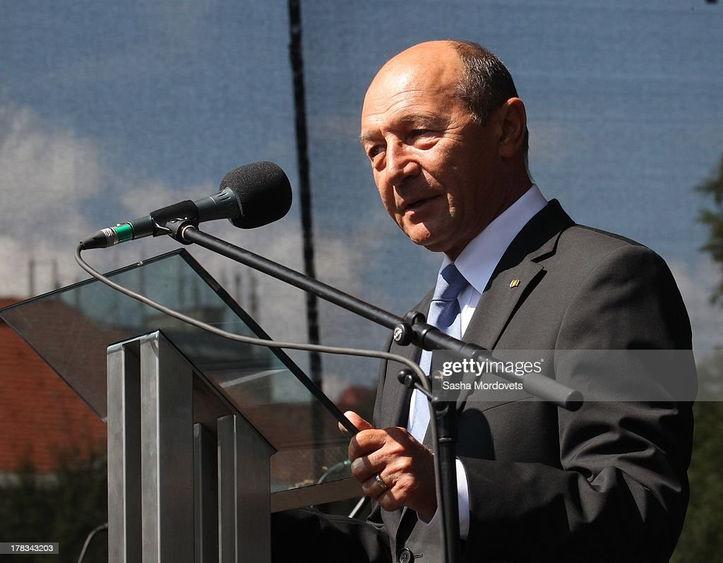 Romanian President <a gi-track='captionPersonalityLinkClicked' href=/galleries/search?phrase=Traian+Basescu&family=editorial&specificpeople=542324 ng-click='$event.stopPropagation()'>Traian Basescu</a> speaks during the 69th anniversary celebrations of the Slovak National Uprising on August 29, 2013 in Banska Bystrica, Slovakia. Romanian President <a gi-track='captionPersonalityLinkClicked' href=/galleries/search?phrase=Traian+Basescu&family=editorial&specificpeople=542324 ng-click='$event.stopPropagation()'>Traian Basescu</a> is on an official two-day visit to Slovakia.