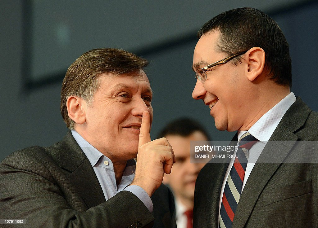 Romanian Prime Minister and Social Liberal Union (USL) co-president Victor Ponta (R) laughs together with Crin Antonescu, the co-leader of USL and President of National Liberal Party during an electoral rally in Craiova city (240km west from Bucharest) December 7, 2012. Ruling coalition Social Liberal Union (USL) and opposition coalition ARD are the main competitors for the votes of Romanians who will go to polls on December 9, 2012 to vote for the new parliament. Romania, still recovering from a painful austerity drive, will have to walk a tightrope between cutting spending and spurring growth no matter who wins polls on December 9, analysts warn.