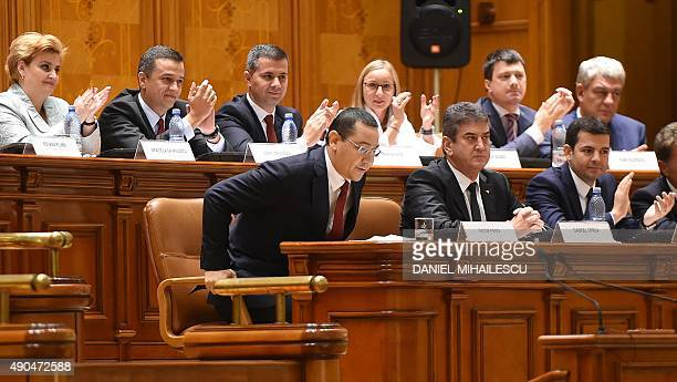 Romanian Prime Minister Victor Ponta is applauded by members of his cabinet after delivering a speech at the Romanian Parliament in Bucharest...