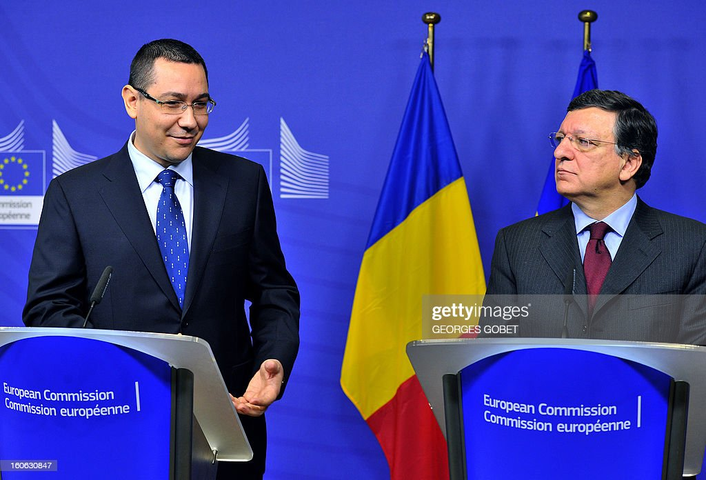 Romanian Prime Minister Victor Ponta (L) smiles during a joint press conference with European Commission President Jose Manuel Barroso after their working session on Feburary 4, 2013 at the EU Headquarters in Brussels.