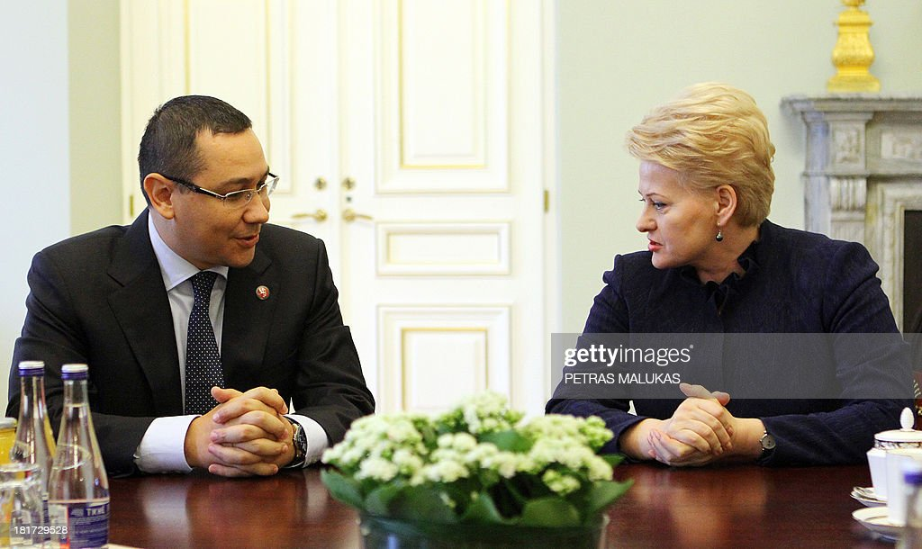 Romanian prime minister Victor Ponta (L) speaks with Lithuania President Dalia Grybauskaite (R) at the presidential palace in Vilnius on September 24, 2013.