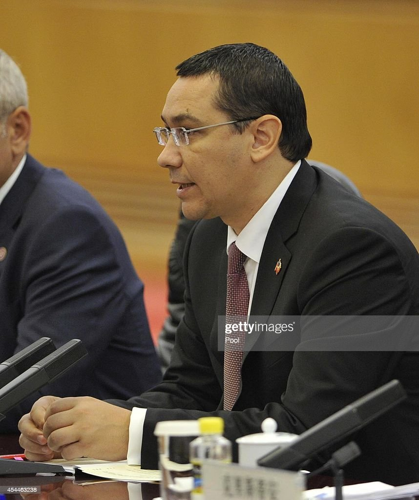Romanian Prime Minister <a gi-track='captionPersonalityLinkClicked' href=/galleries/search?phrase=Victor+Ponta&family=editorial&specificpeople=6752065 ng-click='$event.stopPropagation()'>Victor Ponta</a> talks with Chinese Premier Li Keqiang(not seen) during a meeting at the Great Hall of the People on September 1, 2014 in Beijing, China. The Romanian Prime Minister is on a three day visit to China to strengthen their economic relationship.