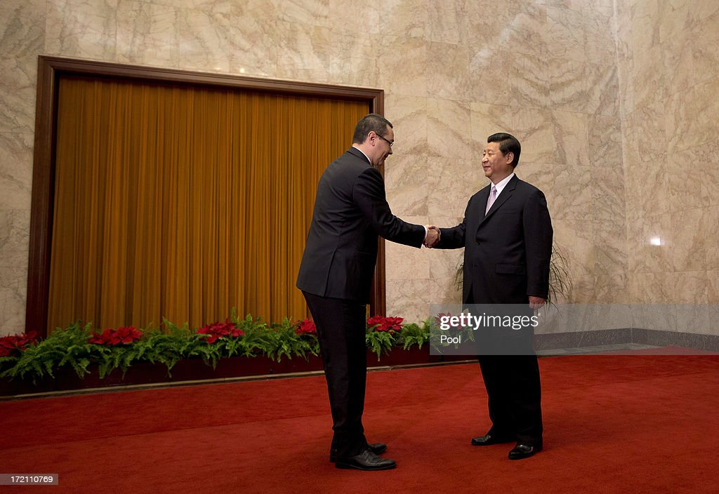 Romanian Prime Minister Victor-Viorel Ponta is greeted by Chinese President Xi Jinping upon arrival for a meeting at the Great Hall of the People on July 2, 2013 in Beijing, China. Victor-Viorel Ponta and Nikola Gruevski are in China to attend a conference with local leaders and central and east European countires from July 2 to 4.