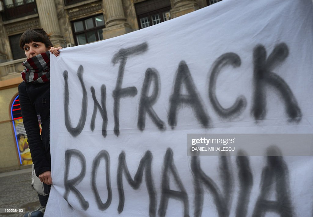 Romanian protesters holds a banner during a demonstration against hydraulic fracturing (fracking) in Bucharest April 4, 2013. Around 300 protesters gathered in Bucharest's University Square in protest against the drilling technique, which uses high pressure injections of water, sand and chemicals to crack open rock and release oil and gas trapped inside. Hundreds of Romanians rallied in several cities to protest against shale gas drilling, voicing concerns over environmental pollution and health hazards.The protesters called on the centre-left government to revoke permits granted to several oil groups, including US giant Chevron, enabling them to start exploration drilling. 'Chevron, go home,' and 'Down with traitors', they chanted, in reference to Prime Minister Victor Ponta who earlier this year said he was favorable to shale gas drilling after repeatedly declaring he was against, while he was in opposition.Nearly 1,000 people rallied in Barlad, an eastern Romanian city lying close to a 600,000 hectare concession granted to Chevron.Several hundred persons also staged a protest in Buzias, a resort famous for its mineral water lying in a western Romanian region where a Luxembourg-based company plans to start drilling. A U.S. Energy Information Administration study said the joint reserves for Romania, Bulgaria and Hungary were around 538 billion cubic metres, among the biggest in eastern Europe.