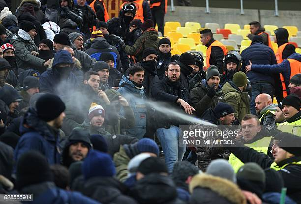 A Romanian security official spray tear gas at supporters of AS Roma at the UEFA Europa League Group E football match between FC Astra Giurgiu and AS...