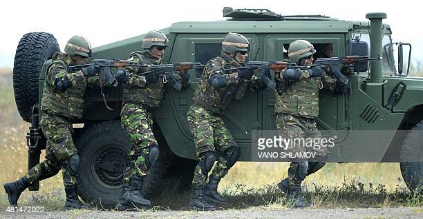 Romanian soldiers take part in a multinational NATO military exercise 'Agile Spirit 2015' at the Vaziani military base outside Tbilisi on July 21...