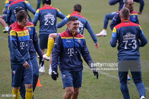 Romanian striker Claudiu Keseru laughs during a training session on March 26 on the eve of the friendly football match Romania against Spain in Cluj...