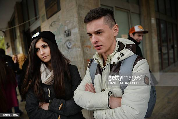 Romanian students at the university of economics give an interview with AFP in Bucharest on December 12 2013 Romanians and Bulgarians react with...