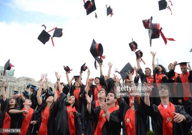 Romanian students from 'Ion Creanga' high school throw their hats as they celebrates graduation in Bucharest on May 31 2012 AFP PHOTO/ DANIEL...