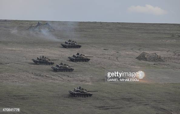 Romanian tanks fire during the NATO 'Wind Spring 15' military exercise at Smardan military shooting range on April 21 2015 Over 2200 servicemen of...