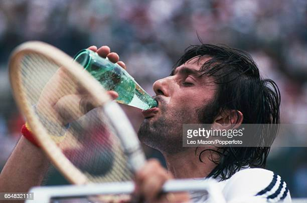 Romanian tennis player Ilie Nastase pictured drinking a bottle of mineral water during competition to be knocked out in the first round of the Men's...