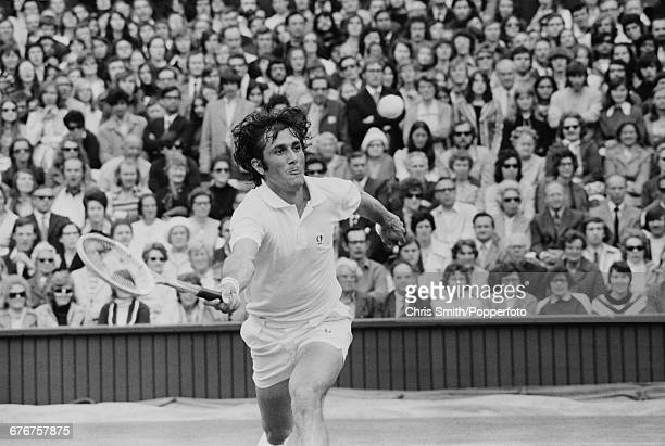 Romanian tennis player Ilie Nastase pictured in action during competition to win his fourth round match against American tennis player Tom Gorman...