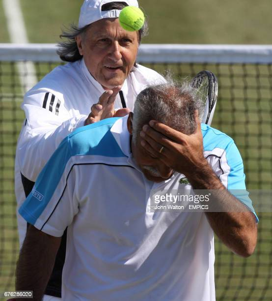 Romanian tennis player Ilie Nastase throws a ball at his Iranian team mate Mansour Bahrami during day one of Nottingham Masters 2009