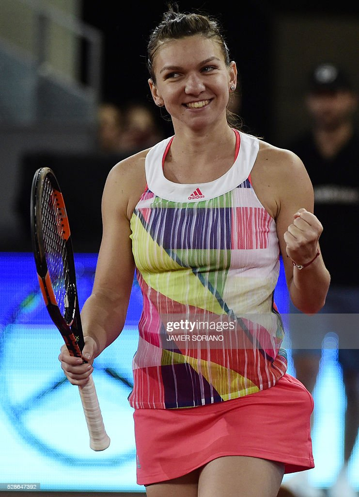 Romanian tennis player Simona Halep celebrates after winning her match against Australian tennis player Samantha Stosur during the Madrid Open tournament at the Caja Magica (Magic Box) sports complex in Madrid on May 6, 2016. / AFP / JAVIER