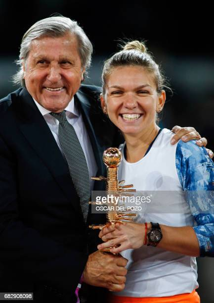 Romanian tennis player Simona Halep poses with Romanian former tennis player Ilie Nastase after winning to French tennis player Kristina Mladenovic...