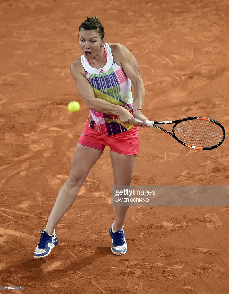 Romanian tennis player Simona Halep returns a ball to Australian tennis player Samantha Stosur during the Madrid Open tournament at the Caja Magica (Magic Box) sports complex in Madrid on May 6, 2016. / AFP / JAVIER
