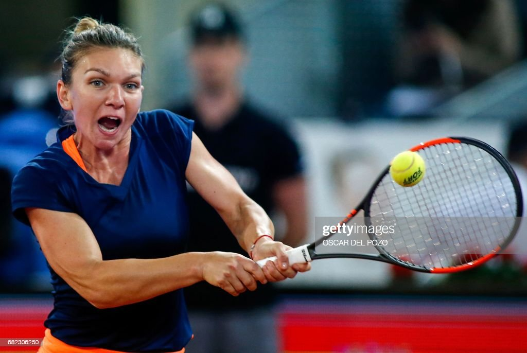 Romanian tennis player Simona Halep returns the ball to Latvian tennis player Anastasija Sevastova during the WTA Madrid Open semi final match in Madrid, on May 12, 2017. Halep won 6-2 and 6-3. /