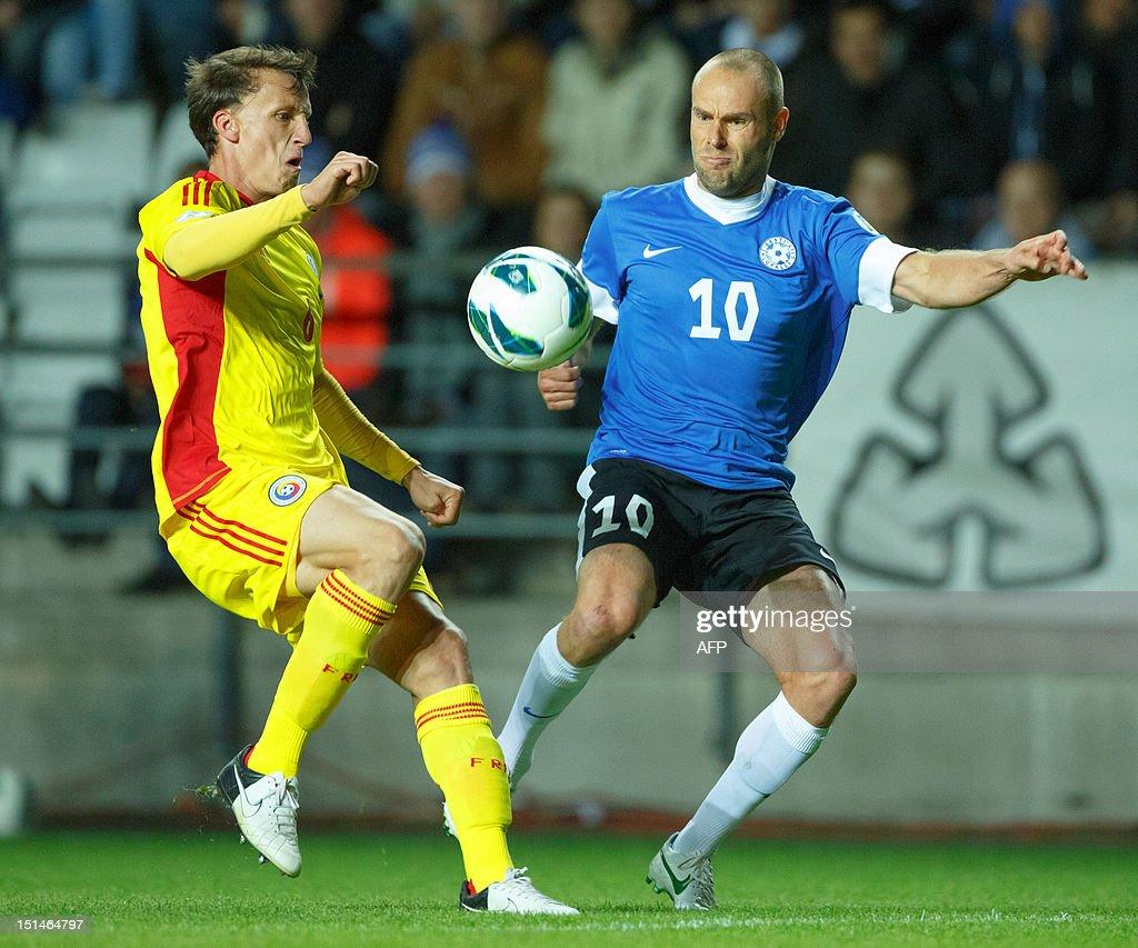 Romania's Alexandru Bourceanu (L) vies with Estonia's Joel Lindpere during the FIFA 2014 World Cup qualifying football match Estonia vs. Romania on September 7, 2012 in Tallin. Romania won 2-0. AFP PHOTO / Jarek Joepera