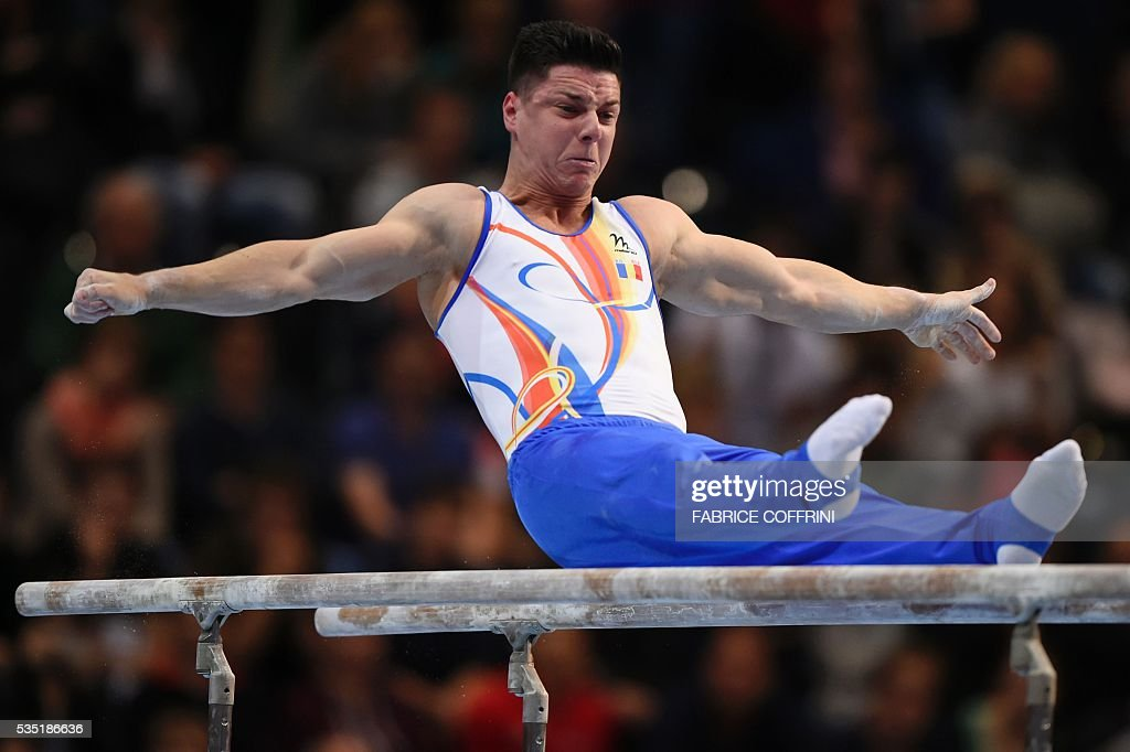 Romanias Andrei Vasile Muntean performs during the Mens Parallel Bars competition of the European Artistic Gymnastics Championships 2016 in Bern, Switzerland on May 29, 2016. / AFP / FABRICE