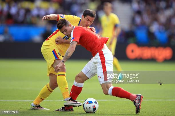Romania's Bogdan Stancu and Switzerland's Granit Xhaka battle for the ball