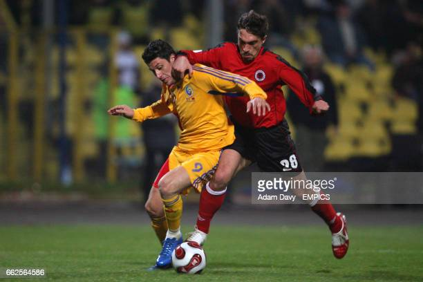Romania's Ciprian Marcia and Albania's Nevil Dede battle for the ball