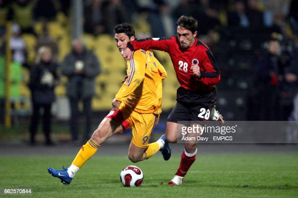 Romania's Ciprian Marica and Albania's Nevil Dede battle for the ball